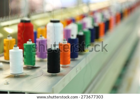 reels of thread on Machine embroider - stock photo