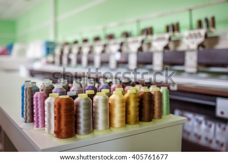 reels of thread with Machine embroider background  - stock photo