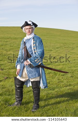 Reenactor in 18th century British army infantry officer uniform - stock photo