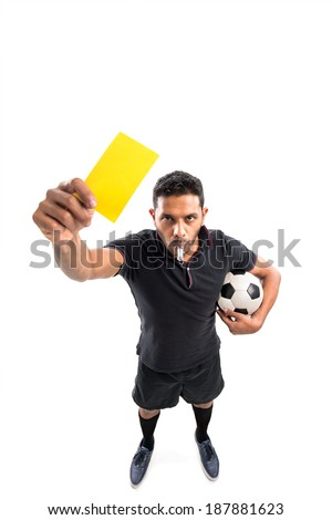 Referee holding a yellow card, view from above - stock photo
