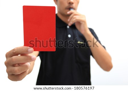 Referee showing a red card on white background - stock photo