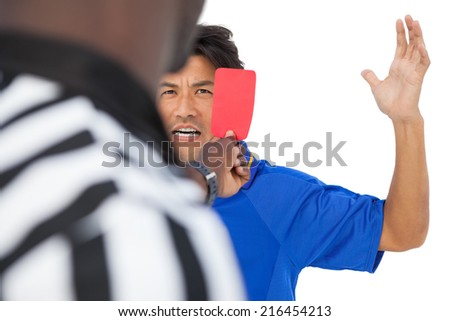 Referee showing red card to football player over white background - stock photo