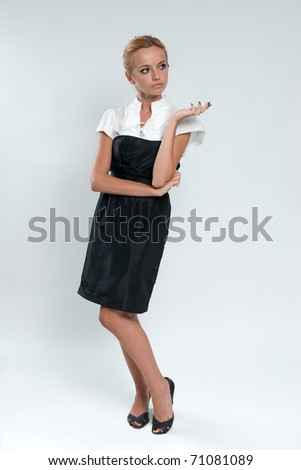 Refined sexy blonde! Lady against grey background wearing fashionable dress studio shot. - stock photo