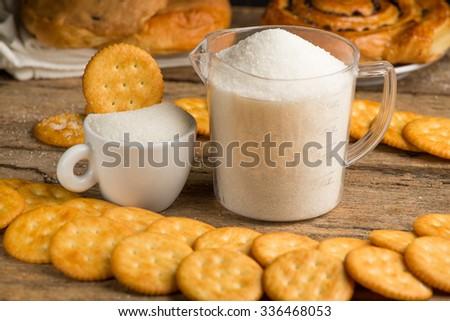 refined sugar and granulated sugar and cracker - stock photo