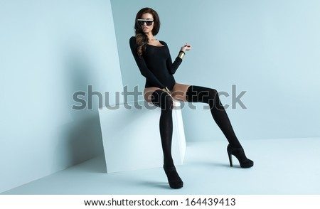 Refined woman wearing black stockings - stock photo