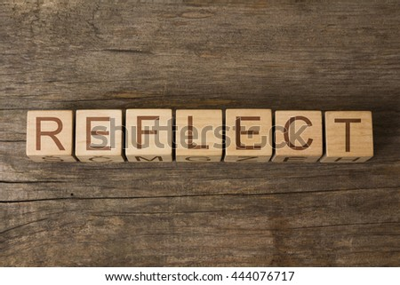 REFLECT word on a wooden cubes - stock photo
