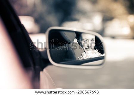 reflected in the car mirror bride - stock photo