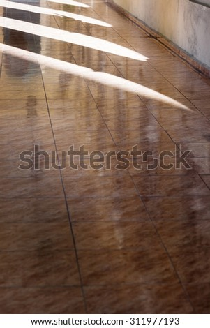 reflected on the marble floor tiles - stock photo