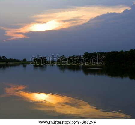 Reflected Sunset Over Pond - stock photo