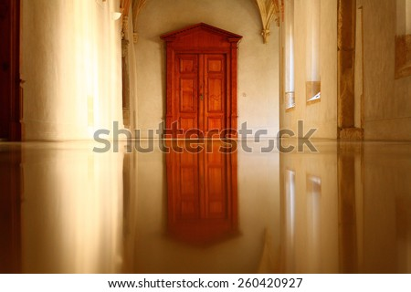 Reflected wooden door purity interior symmetric symmetrical morning lights - stock photo