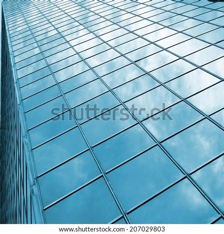 reflecting modern skyscraper glass - stock photo
