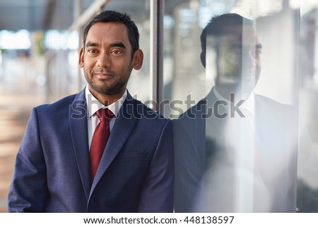 Reflecting on his business success - stock photo