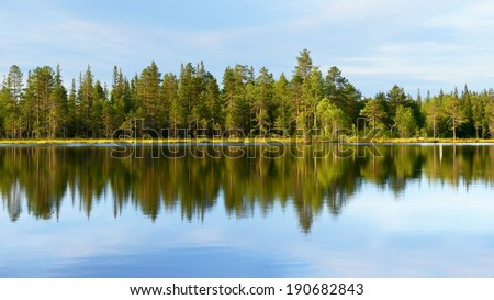 Reflection in Blue Laked, North Finland, Laplan - stock photo