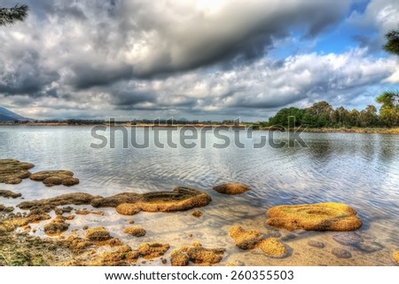 reflection in lake Calik in Sardinia. Processed for hdr tone mapping effect - stock photo
