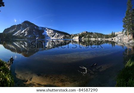 reflection in Peeler lake in the Sierra Nevada mountains of California - stock photo