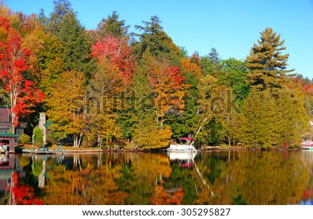 Reflection in Saranac Lake, Autumn in the Adirondacks, New York - stock photo