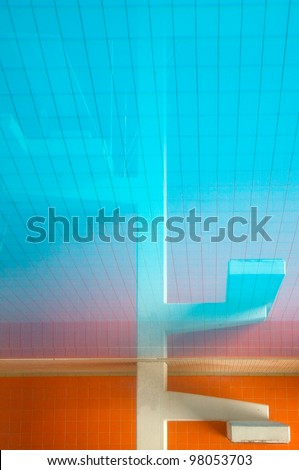 Reflection of a diving platform - stock photo