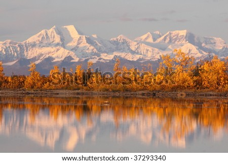 Reflection of Alaskan Range - stock photo
