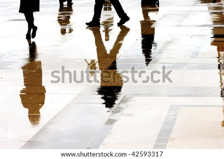 reflection of any nobody equipped with jacket in the street - stock photo