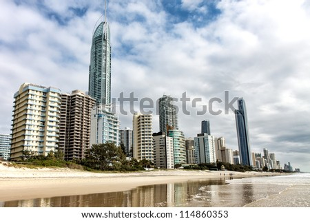 Reflection of apartments in sea at sunrise, Gold Coast, Australia - stock photo