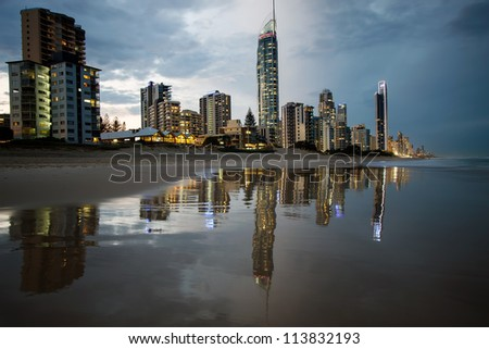 Reflection of apartments in sea at sunset, Gold Coast, Australia - stock photo