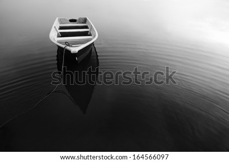 Reflection of Boat During in Black and White - stock photo