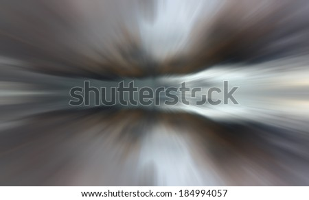 Reflection of clouds with long exposure effect, zoom blurred - stock photo