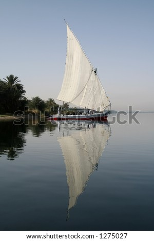Reflection of felucca at Nile River, Egypt - stock photo