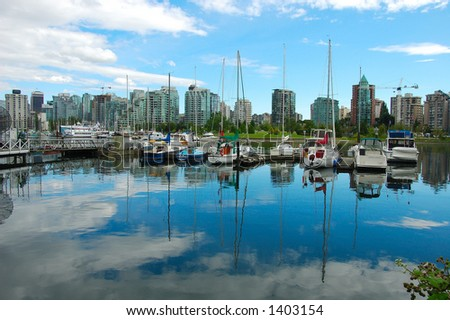reflection of harbor near Vancouver downtown - stock photo