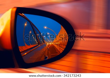 Reflection of  hidgway in the mirror of a car - stock photo
