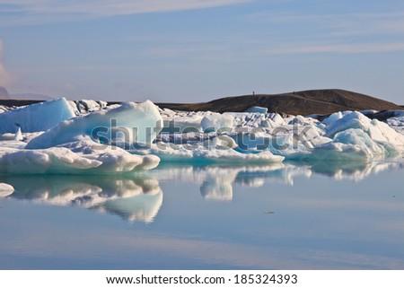 Reflection of Jokulsarlon Lagoon- the famous ice land in iceland  - stock photo