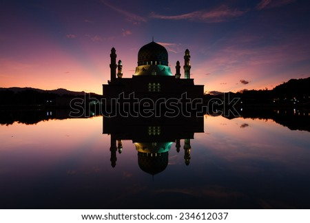 Reflection of Kota Kinabalu city mosque at sunrise - stock photo