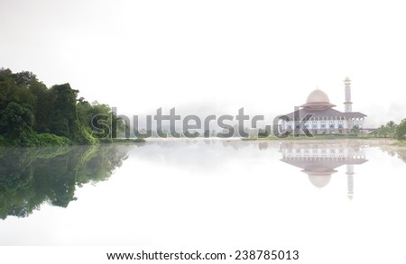 Reflection of mosque  - stock photo