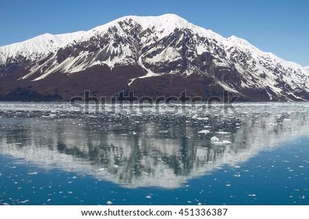 Reflection of Mountain Close to Hubbard Glacier in Alaska. - stock photo