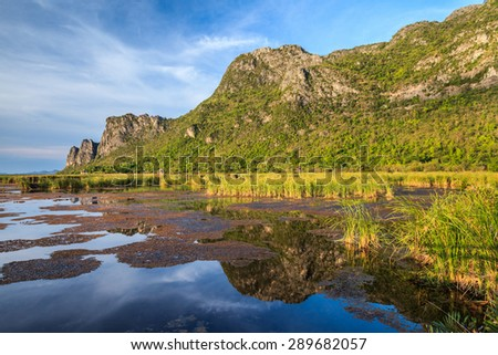 Reflection of Mountain Rock in the marshes - stock photo