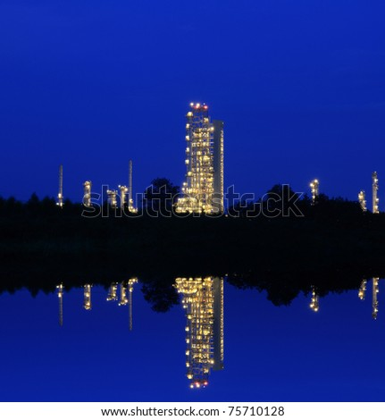 Reflection of petrochemical industry on blue sky. - stock photo