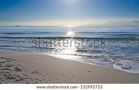 reflection of sunlight on the water - stock photo