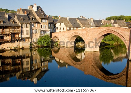 Reflection of the bridge of Espalion in Aubrac, France - stock photo