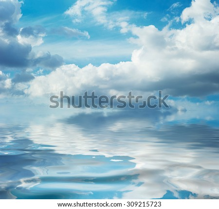 Reflection of the sky in calm water. Daytime for daydreaming. Imagination. Mirror of the shallow sea. Tranquil romantic seascape. Shoal area. Idillic marine scene. Ripple on ocean surface. - stock photo