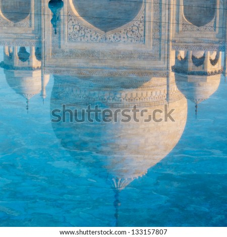 Reflection of the Taj Mahal dome in the water, Agra, India. - stock photo