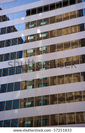 Reflection of two office buildings - stock photo