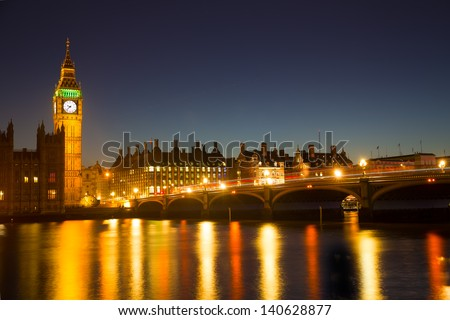 Reflection of Westminster Bridge and the Elizabeth Tower (Big Ben) of the Palace of Westminster in the River Thames - stock photo