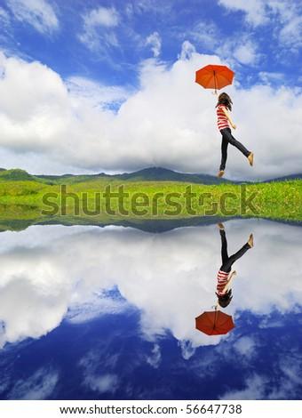 Reflection Red umbrella woman - stock photo