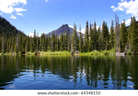 Reflections at swift current lake in Glacier national park - stock photo