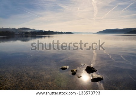 Reflections in Lake Windermere - stock photo