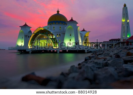 Reflections of famous floating mosque on water of sea in Malacca, Malaysia, Asia. - stock photo