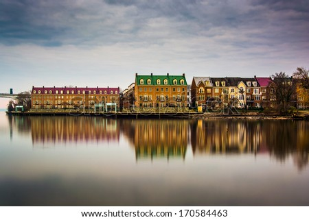 Reflections of waterfront buildings along the Potomac River in Alexandria, Virginia. - stock photo