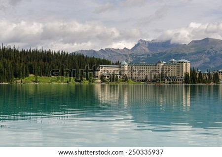reflections on Lake Louise in Canada - stock photo