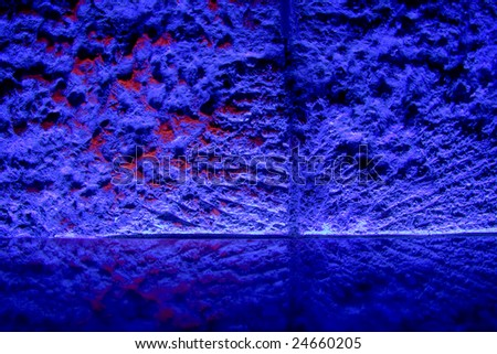 Reflective shelf on a stone wall in a night bar illuminated by neon lights. Nice background for your products or objects. - stock photo
