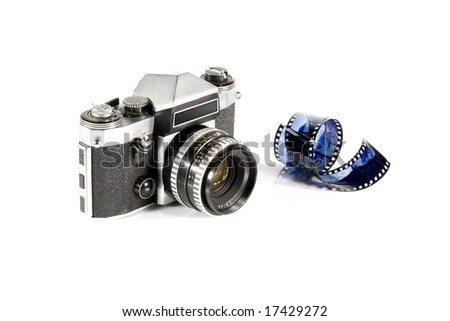 Reflex photo camera and film - stock photo